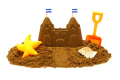 Sand castle. With child's beach toys isolated on white royalty free stock photography
