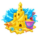 Sand castle with childs toys and blue waves on background Royalty Free Stock Images