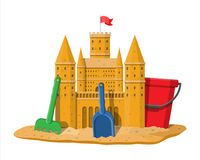 Sand castle or handmade sculpture. Sand castle. Sandcastle handmade sculpture. Plastic bucket with rake, shovel. Fortress with towers. Fort with gates and flag Royalty Free Stock Photography