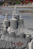 Sand Castle Isolated on Beach. Sand Castle with crushed shell turrets on a beach, isolated royalty free stock photos