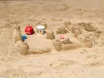 The sand castle made by children on the sandy beach.  Stock Photos