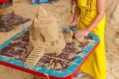 Sand castle made by kids on a craft lesson on beach. Sand castle made by kids on a craft lesson on summer beach stock photos