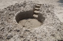 Sand castle in the making Royalty Free Stock Photos