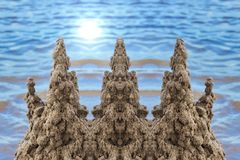 Sand castle near the water children's buildings with their own h. Sand castle near the water children's buildings with their hands the child learns the world royalty free stock photo