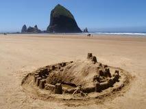 Sand castle on ocean beach stock photos