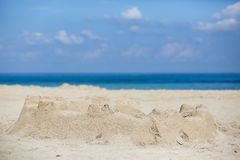 Sand castle on a sandy beach Stock Image