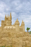 Sand castle sculpture. Sand sculpture of a castle with cloudy sky in background during sand sculptures festival in Burgas, Bulgaria Royalty Free Stock Photos