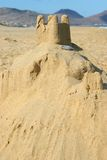 Sand castle by the sea. With beach as background Stock Photography