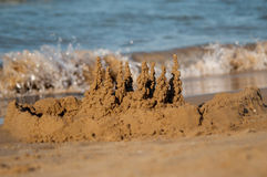 Sand castle with sea as a background Royalty Free Stock Image