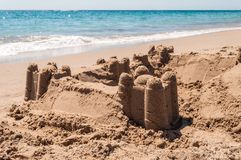 Sand castle on the sea shore Royalty Free Stock Photos