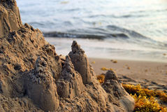 Sand castle and seaweed Royalty Free Stock Photo