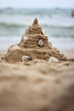 Sand castle. Shell sand castle on beach in holiday Stock Photo