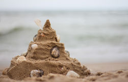 Sand castle. Shell sand castle on beach in holiday Royalty Free Stock Photos