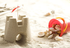 Sand castle and shells Royalty Free Stock Image