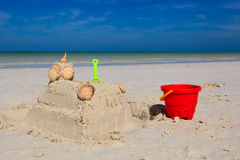 Sand castle with shells built on tropical beach Stock Photography