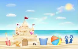 Sand castle and shovel bucket and ball on a sea beach Stock Photography