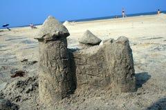 Sand Castle with Slanted Horizon. Sand castle on beach with slanted horizon Royalty Free Stock Images