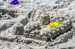 Sand castle structures built at seashore Stock Photography