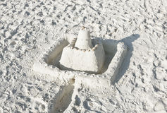 Sand castle on a sunny beach Royalty Free Stock Images