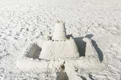 Sand castle on a sunny beach Stock Photography