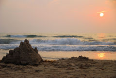 Sand castle at sunrise. With ocean and sun in background. South Padre Island, Texas Royalty Free Stock Image