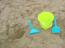 Sand castle and tools Royalty Free Stock Photos