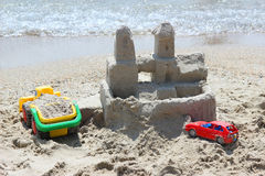 The sand castle and toy machines on the coast. Summer children's holiday Royalty Free Stock Photography