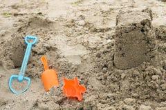 Sand castle. Sand toys on the beach Stock Photography