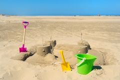 Sand castle with toys at the beach Royalty Free Stock Photos