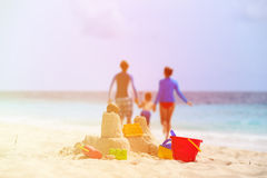 Sand castle on tropical beach, family vacation Stock Image