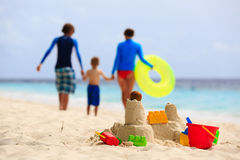 Sand castle on tropical beach, family vacation Royalty Free Stock Images