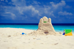 Sand castle on tropical beach Stock Images