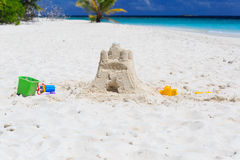 Sand castle on tropical beach Royalty Free Stock Image