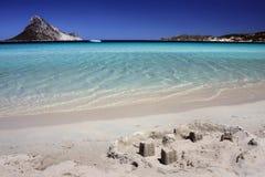 Sand castle on tropical white sand beach.  Stock Photography