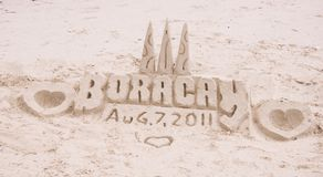 Sand castle on tropical white sand beach Royalty Free Stock Images