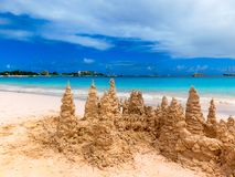 Sand castle on tropical white beach Stock Photo