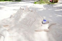 Sand castle on white sand beach Royalty Free Stock Photo