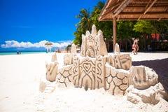 Sand castle on white tropical sandy beach Royalty Free Stock Photo