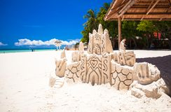 Sand castle on white tropical sandy beach Royalty Free Stock Photo