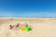 Free Sand Castle With Toys At The Beach Royalty Free Stock Image - 115039556