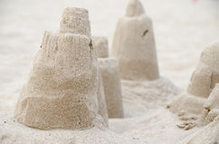 Sand castles on beach. Clean shot of sand castles on a light colored beach stock image