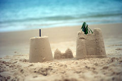 Sand Castles. On a beach with ocean seen in the background Stock Image