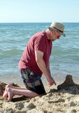 Sand castles and grandpa on a Indiana beach Royalty Free Stock Images