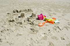 Sand castles and kids toys on the beach Royalty Free Stock Photography