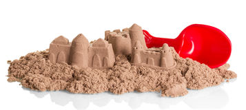 Sand Castles of kinetic  and shovel isolated on white. Sand Castles of kinetic sand and shovel isolated on white background Royalty Free Stock Image
