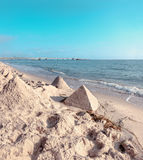 Sand castles in shape of pyramides on a beach on Baltic Sea Stock Photography