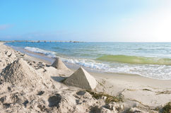 Sand castles in shape of pyramides on a beach on Baltic Sea Royalty Free Stock Image