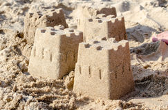 Sand castles on the shore Stock Images
