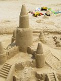 Sand castles and toy trucks Stock Images