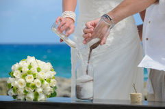 Sand ceremony on the beach Stock Photo